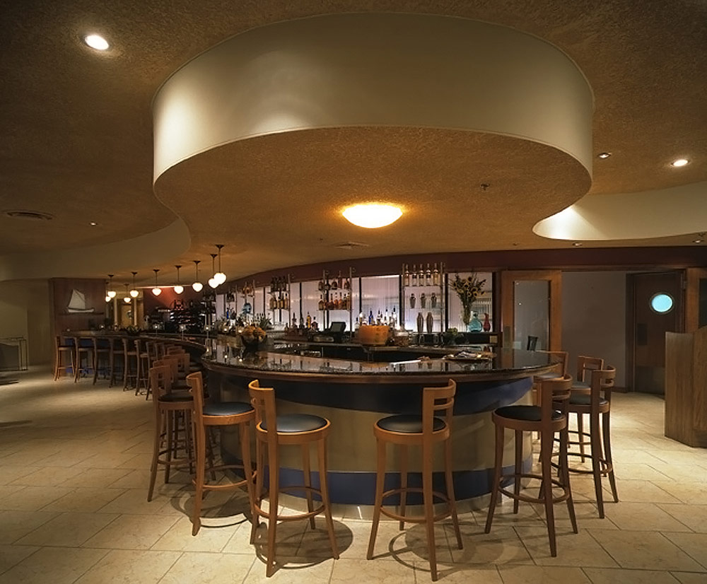 Pyrok acoustical plaster on rounded ceiling above restaurant bar